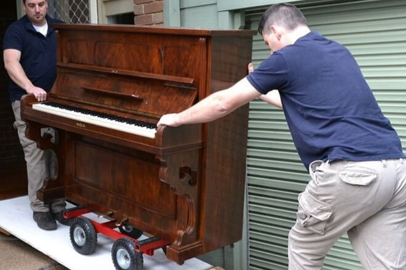 how much do pianos weigh