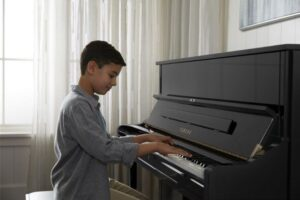 Read more about the article Yamaha Upright Pianos [Specs and Review]